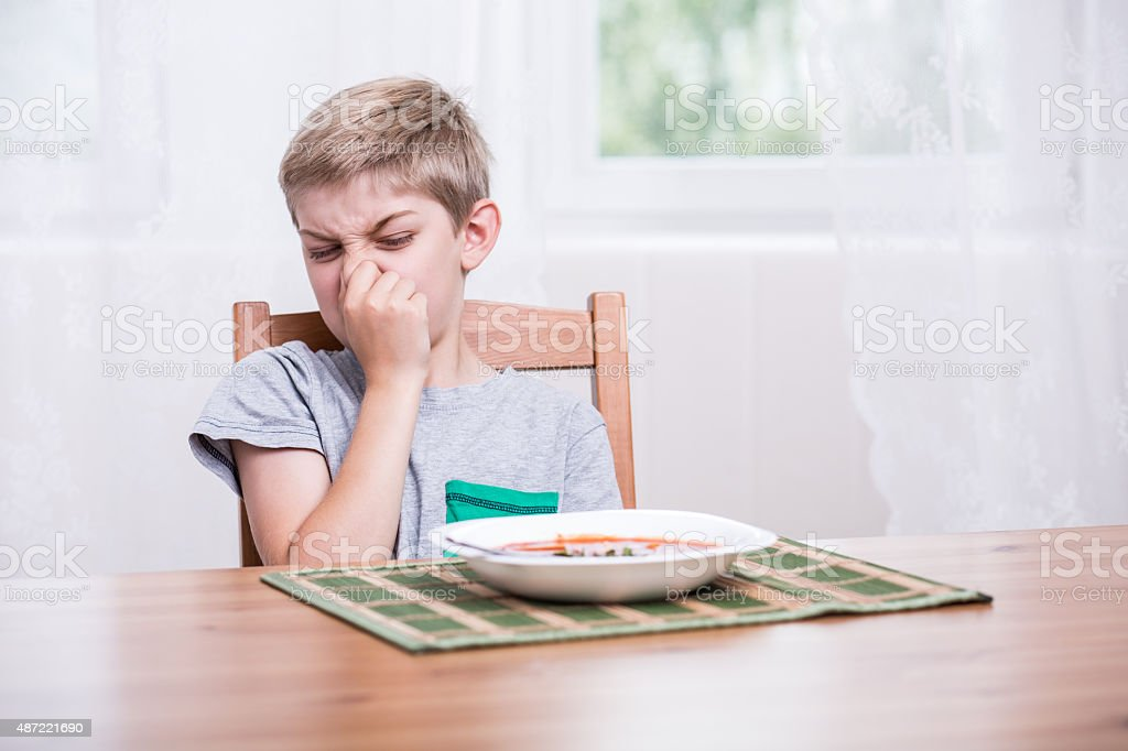 Child refusing to eat soup stock photo
