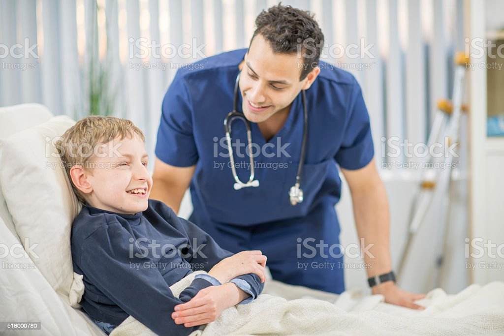 Child Relaxing in a Hospital Bed stock photo