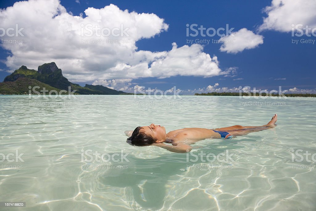 Child relaxing in natural Swimming Pool. royalty-free stock photo