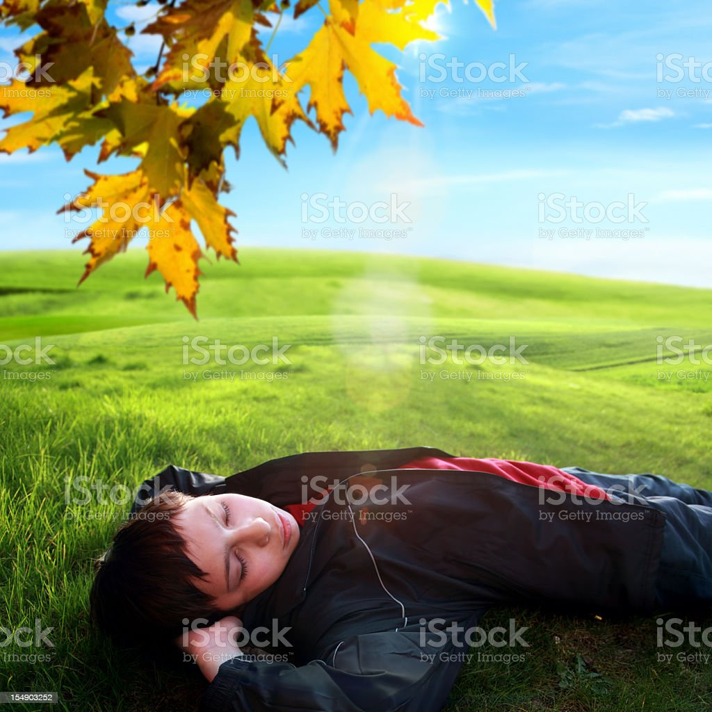 child  resting on green grass royalty-free stock photo