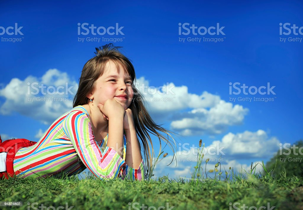 child resting on meadow royalty-free stock photo