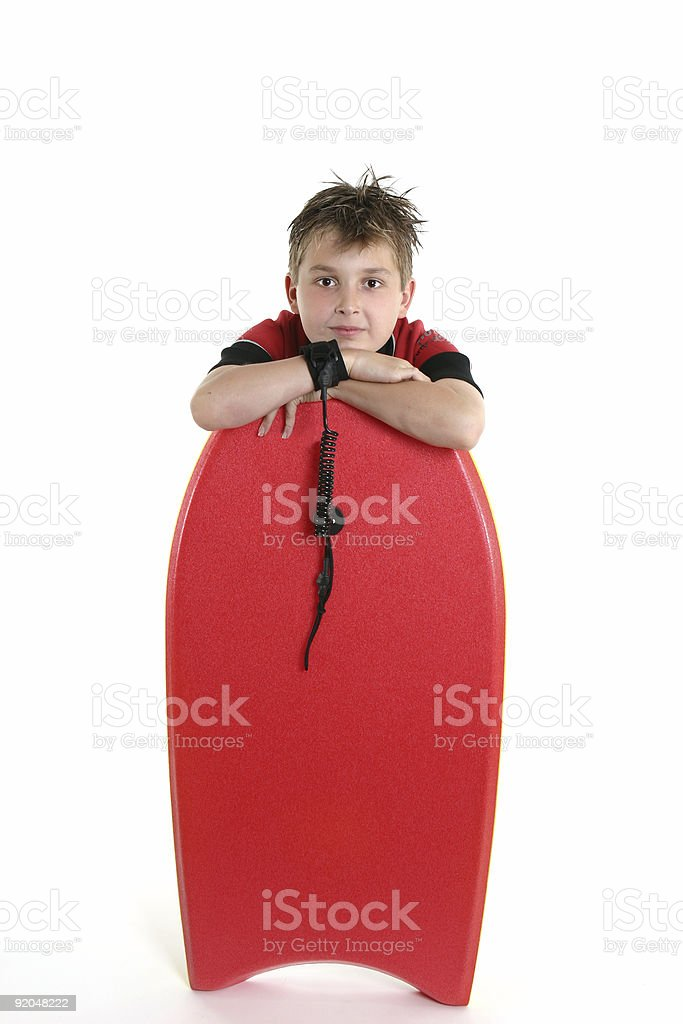 Child resting with a bodyboard stock photo