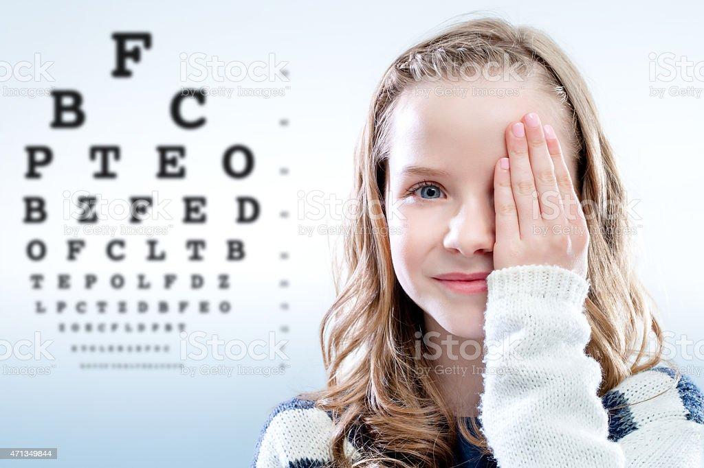Child reviewing eyesight. stock photo