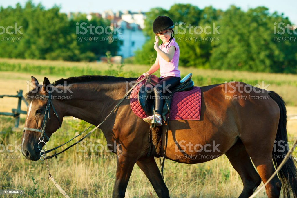 Child Riding Horse Outdoors. royalty-free stock photo