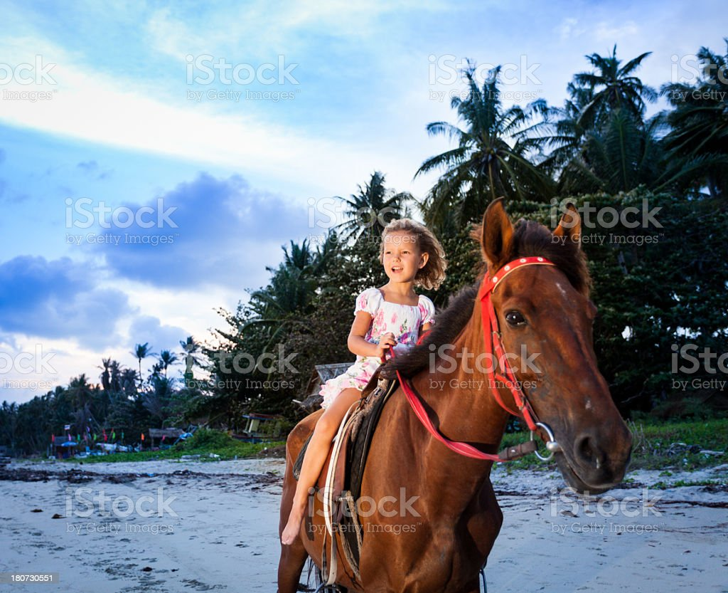 Child Riding Horse Outdoors royalty-free stock photo