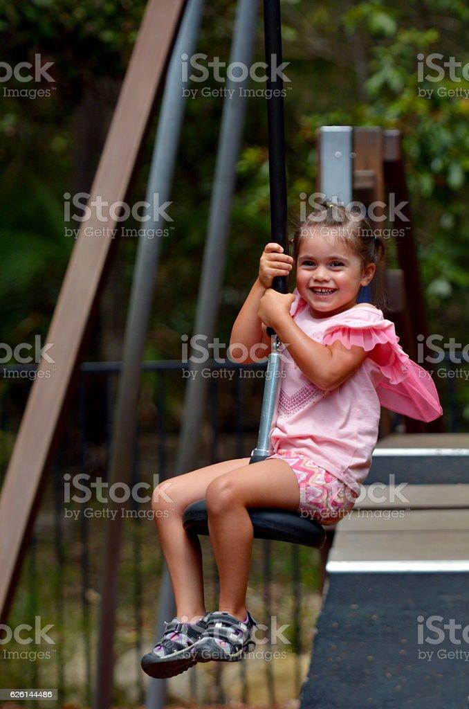 Child rids on Flying Fox stock photo