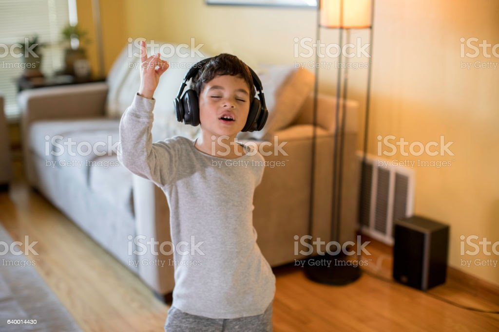 Child Rocking Out to Music stock photo