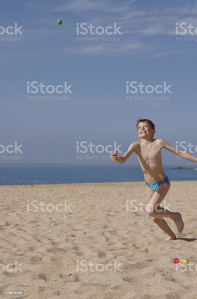 Child runing on beach stock photo
