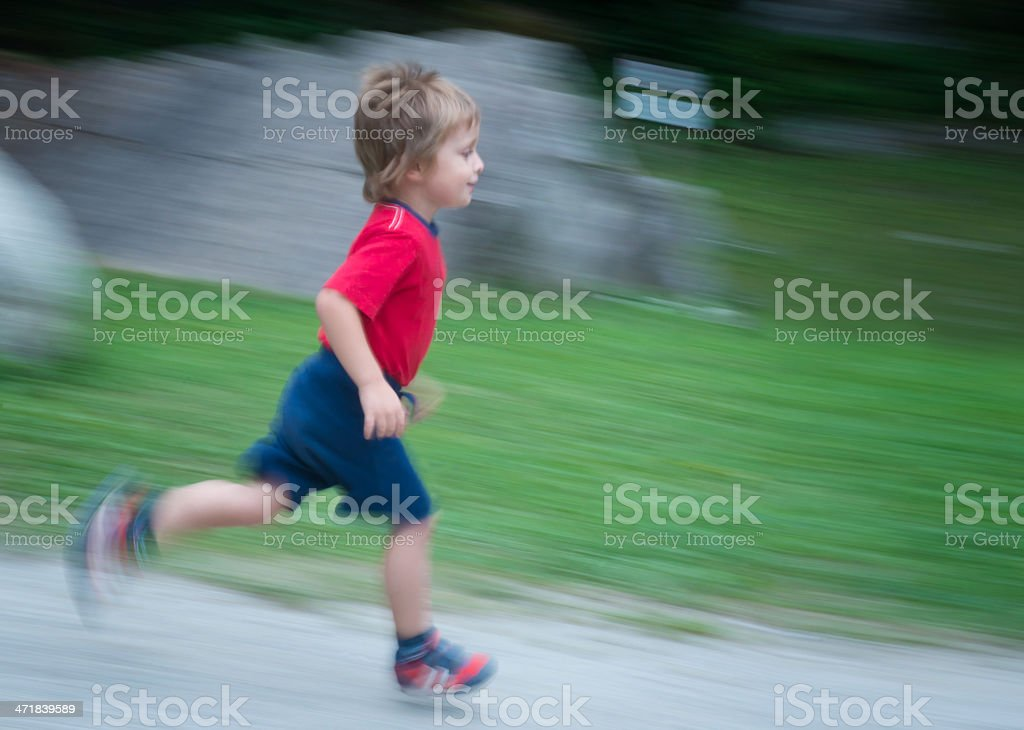 Child Running Downhill. Motion blurred image. royalty-free stock photo