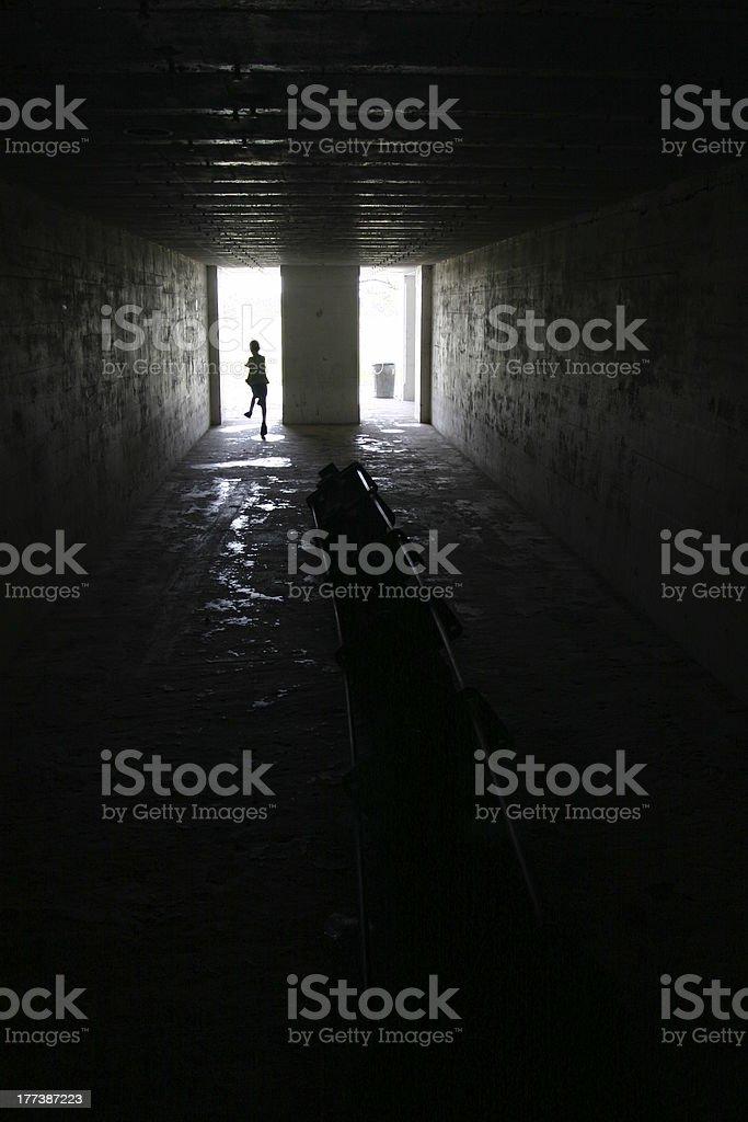 Child running in dark room stock photo