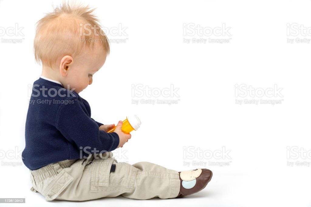 Child safety. Baby with medicine. royalty-free stock photo