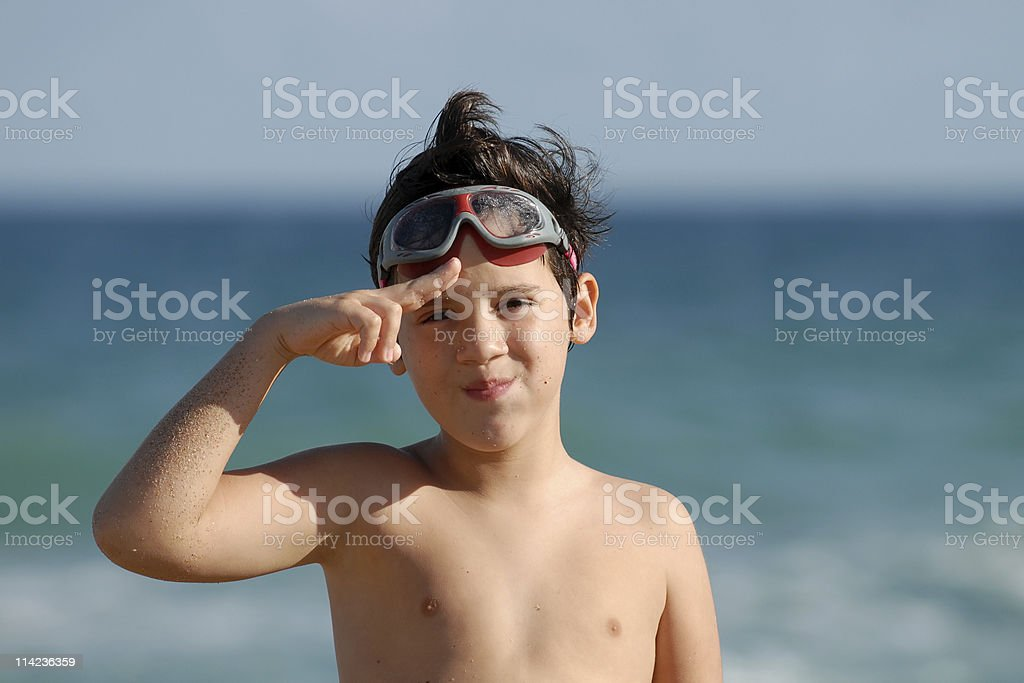 Child saluting at the beach royalty-free stock photo