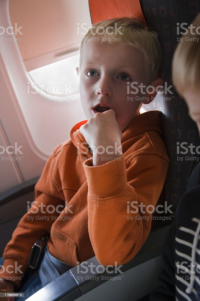 Child sat on a plane royalty-free stock photo
