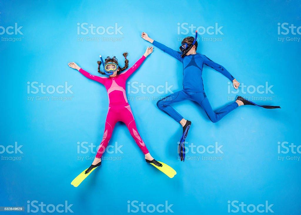 Child scuba divers stock photo