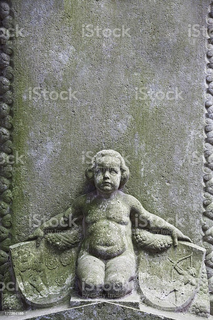 child sculpture with crests royalty-free stock photo
