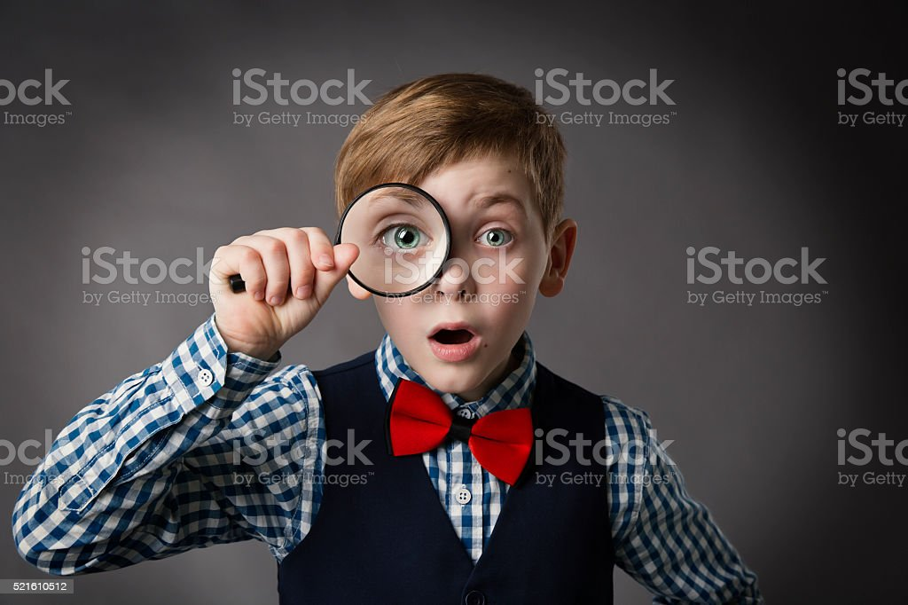 Child See Through Magnifying Glass, Kid Eye Looking Magnifier Lens stock photo