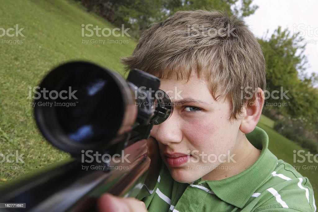 Child shooting a gun royalty-free stock photo