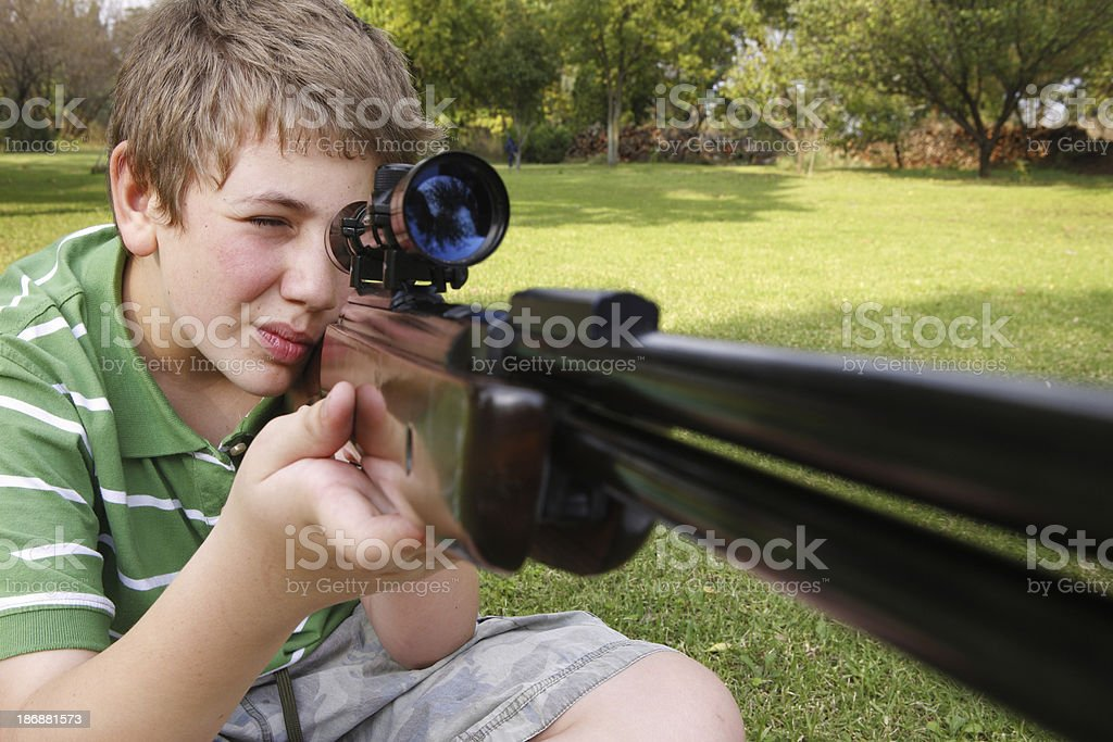 Child shooting a rifle royalty-free stock photo