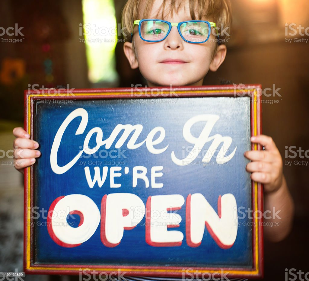 Child Showing an Open Sign stock photo