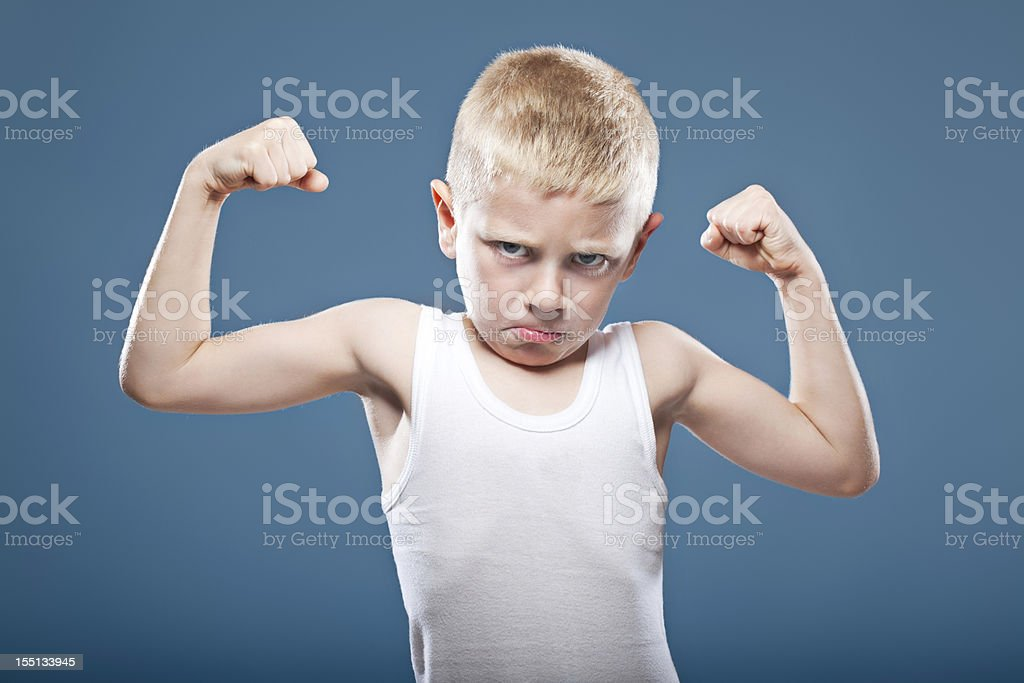 Child showing his muscles royalty-free stock photo