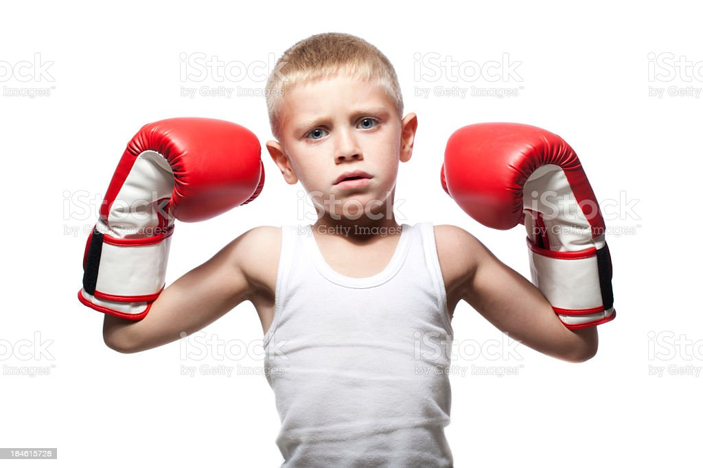 Child showing his muscles with boxing gloves royalty-free stock photo