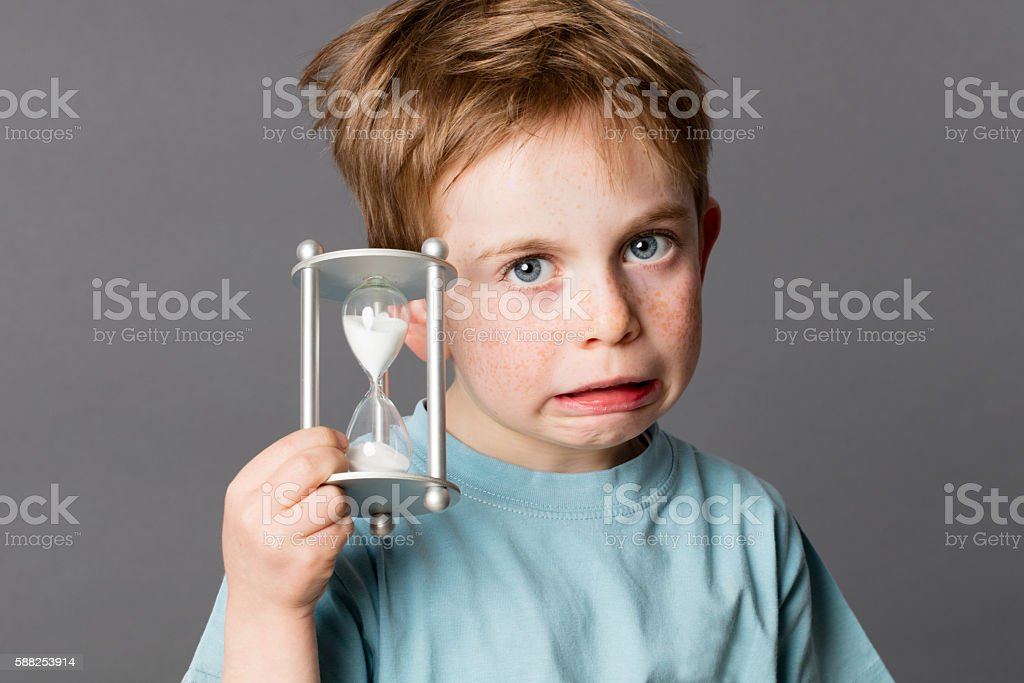 child showing his worry in growing up for time concept stock photo