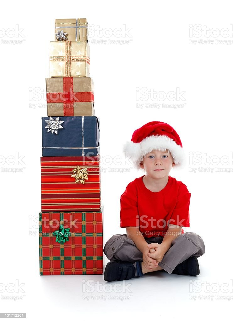 Child sitting near presents royalty-free stock photo