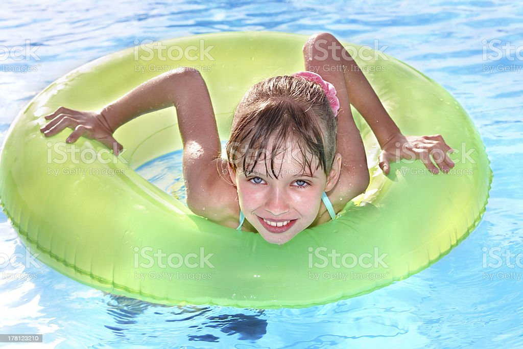 Child sitting on inflatable ring. royalty-free stock photo