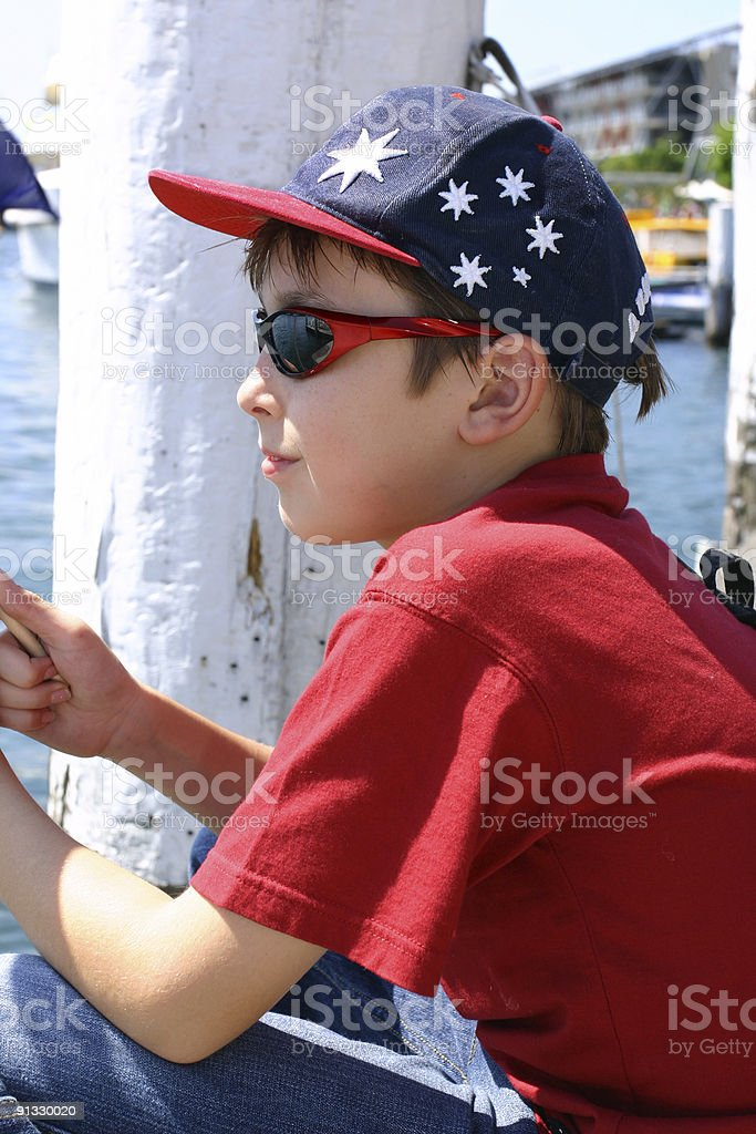 Child sitting on jetty wharf royalty-free stock photo