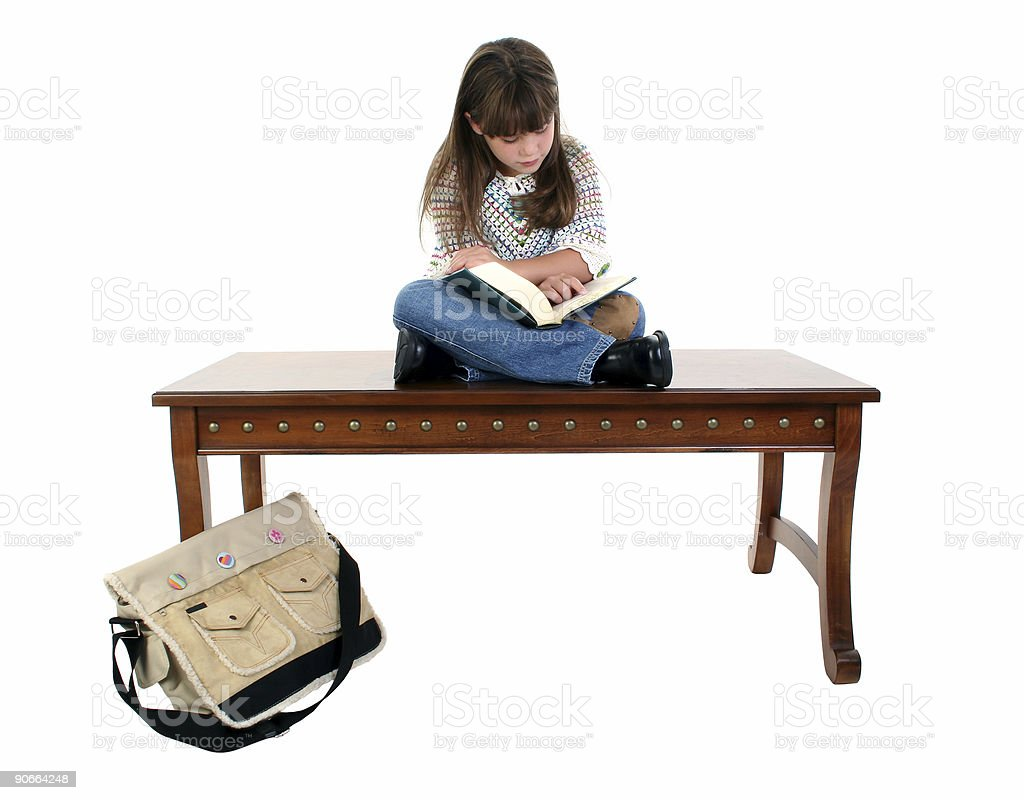 Child Sitting on Table Reading Book royalty-free stock photo