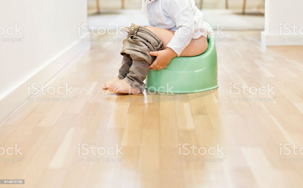 Child sitting on the potty stock photo