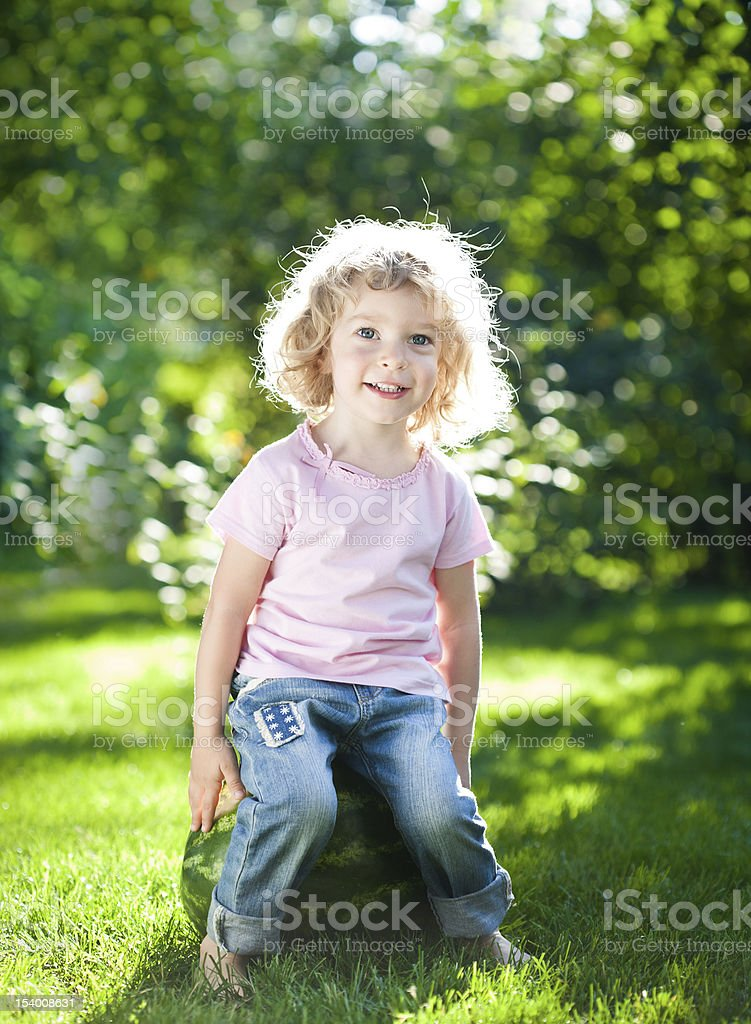 Child sitting on watermelon royalty-free stock photo