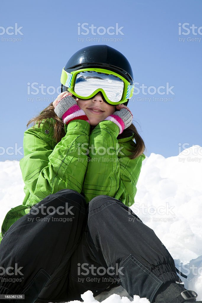 Child skier relaxing royalty-free stock photo
