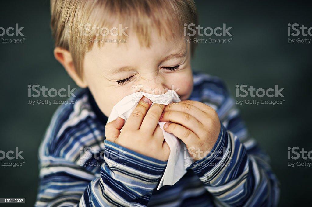 Child sneezing royalty-free stock photo