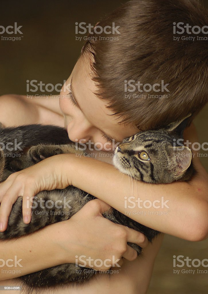 Child Snuggling a Cat~Alternative Therapy royalty-free stock photo