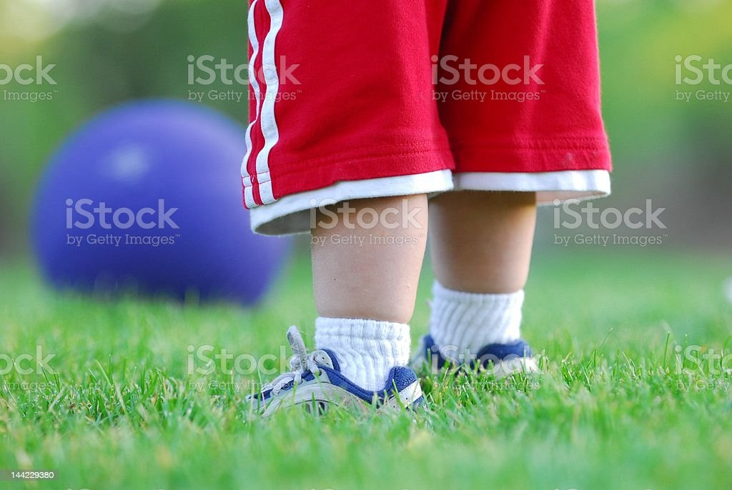 Child standing in grass royalty-free stock photo