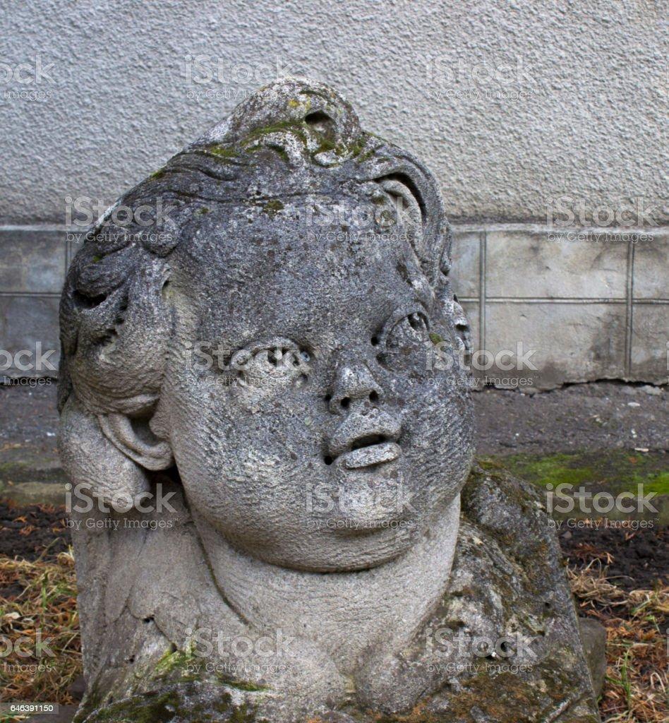 Child statue head in the garden stock photo
