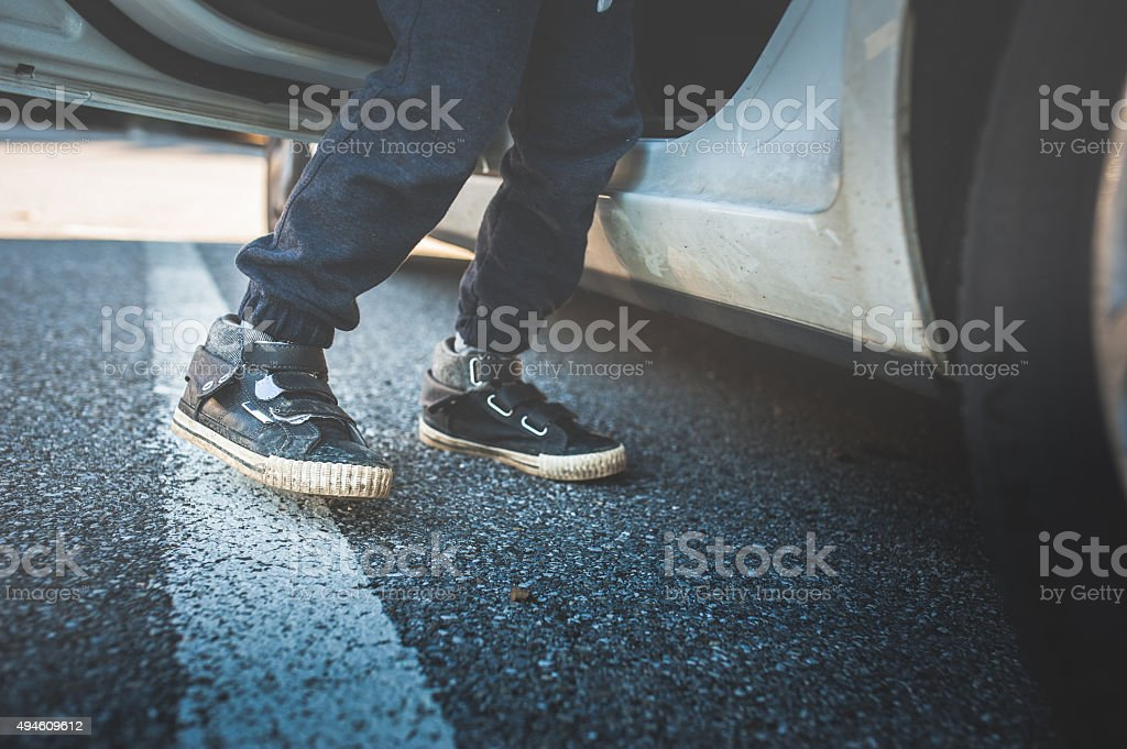 Child Steps Out of a Car stock photo