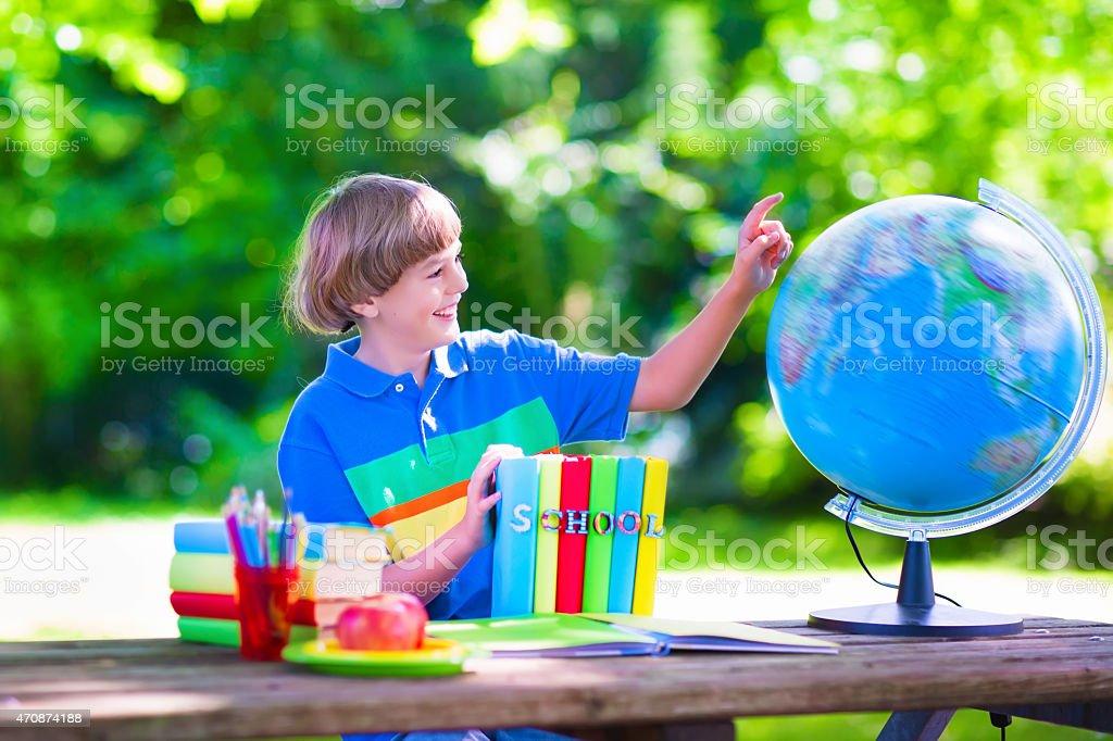 Child studying in school yard stock photo