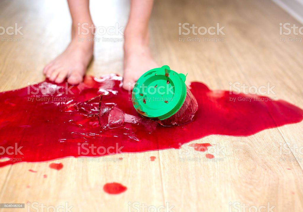 child sweet tooth dropped and smashed a jar of jam stock photo