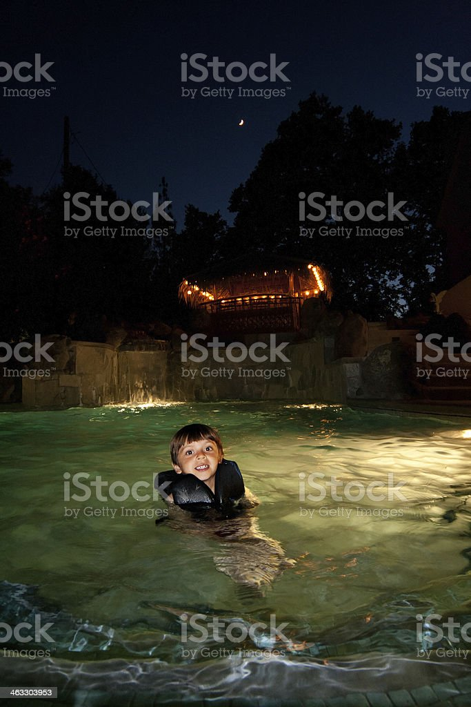 Child Swimming in a Pool stock photo