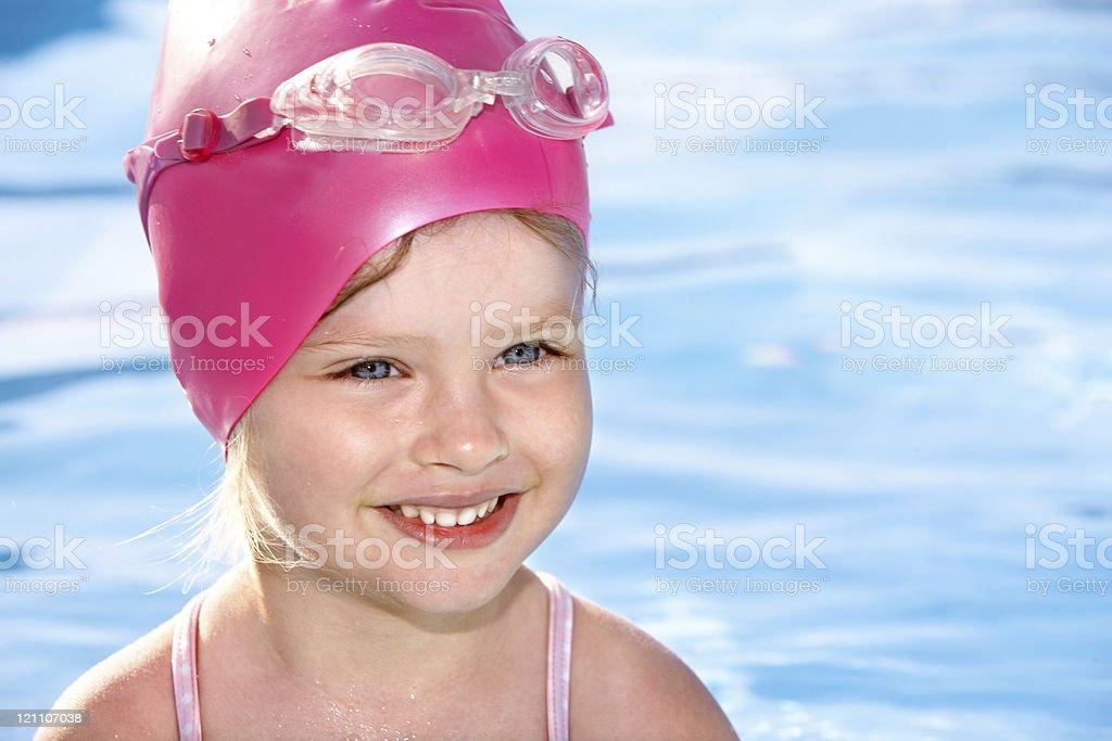Little girl swimming in pool.