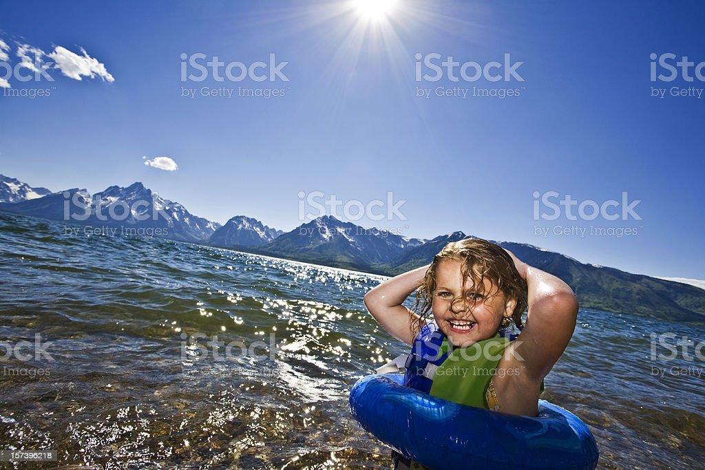Child Swimming Jackson Lake, Grand Tetons National Park. royalty-free stock photo