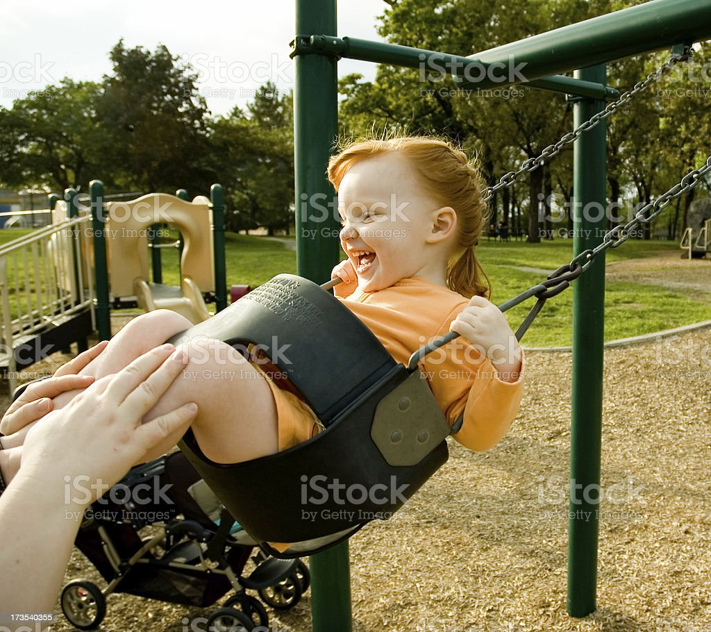 Child Swinging stock photo