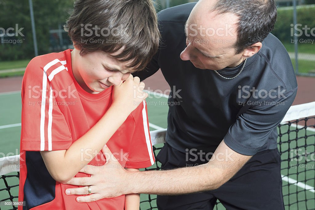 Child Tennis - Shoulder Problem royalty-free stock photo