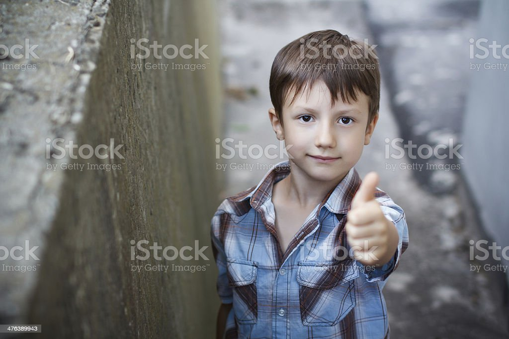 Child thumb up outdoor royalty-free stock photo