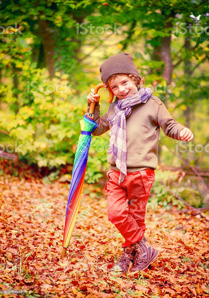 Child, Umbrella and Autumn stock photo