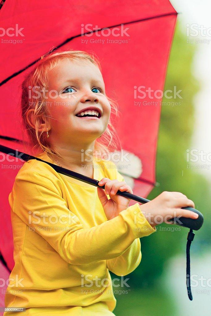Child under umbrella stock photo