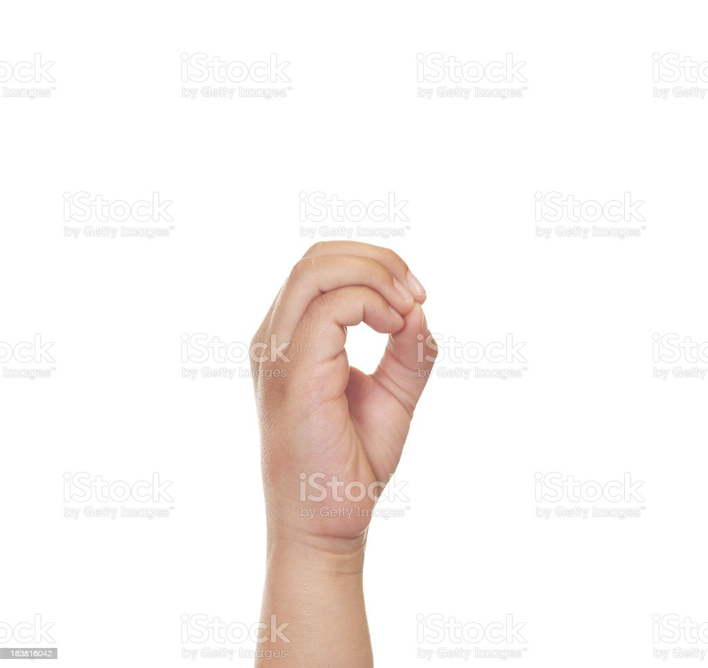 Child Using American Sign Language Letter O royalty-free stock photo
