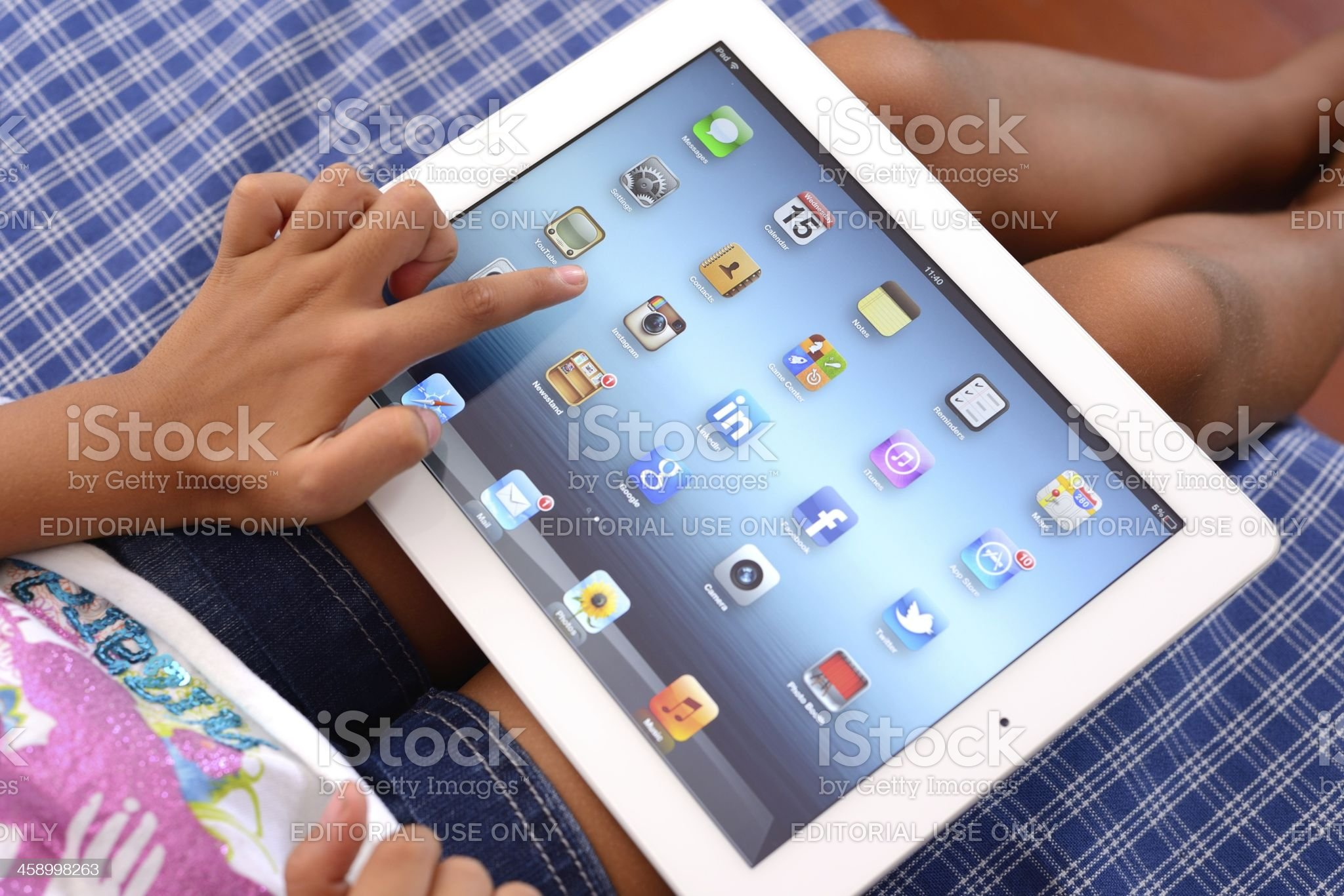 Child using iPad 3 royalty-free stock photo